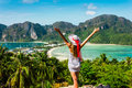The girl at the resort in a dress and hat on the background of the bays of the island of phi phi Royalty Free Stock Image