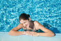 Girl in resort swimming pool Stock Photography