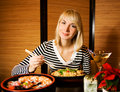 Girl in a restaurant Royalty Free Stock Photography