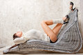 Girl resting in comfortable wicker chair sexy a Royalty Free Stock Image