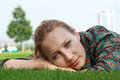 Girl rests upon herb Royalty Free Stock Image