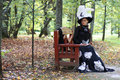 Girl in retro dress past century read letter on bench Royalty Free Stock Photo