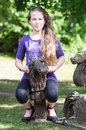 A girl ridding on small wooden horse Stock Images