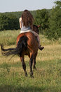 Girl ride away on a sorrel Royalty Free Stock Photo