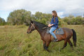 Girl rides on horseback summer siberia Royalty Free Stock Photo