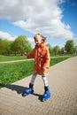 Girl rides on roller skates Stock Image