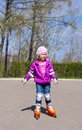 Girl rides roller skates little Stock Image