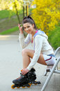 Girl rides rollerblades in the park Royalty Free Stock Images