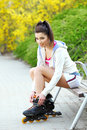 Girl rides rollerblades in the park Royalty Free Stock Photography