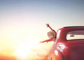 Girl rides into the sunset Royalty Free Stock Photo