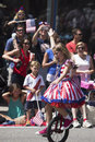 Girl rides unicycle during July 4, Independence Day Parade, Telluride, Colorado, USA Royalty Free Stock Photo