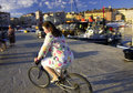 Girl riding bicycle a bike panning taken in rovinj croatia Stock Photo