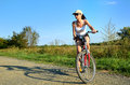Girl riding bicycle in country side Royalty Free Stock Images