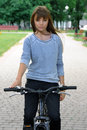 Girl riding a bicycle in the park Stock Photography