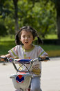 Girl riding bike Stock Photos