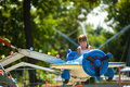 Girl riding carousel Royalty Free Stock Photo