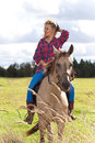 Girl riding horse beautiful akhal teke Royalty Free Stock Photography