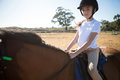 Girl riding a horse in the ranch Royalty Free Stock Photo