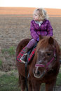 Girl Riding a Pony - baby Ride a Horse Royalty Free Stock Photos