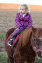 Girl Riding a Pony - baby Ride a Horse Royalty Free Stock Images