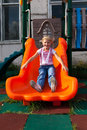 Girl riding rides on a child playground Stock Images