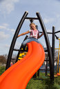 Girl riding rides on a child playground Stock Image