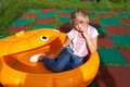 Girl riding rides on a child playground Stock Photography