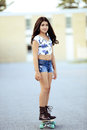 Girl riding on skate board Royalty Free Stock Photo