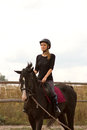 Girl riding trains a a horse Royalty Free Stock Photography