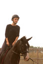 Girl riding trains a a horse Stock Photography