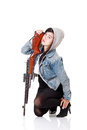 Girl and rifle a cute posing with his Royalty Free Stock Images