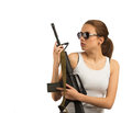 Girl with a rifle m young beautiful woman on white isolated background Stock Photos