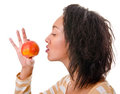 Girl with a ripe apple Royalty Free Stock Photos