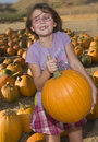 Girl with ripe pumpkin Royalty Free Stock Photography