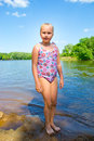 Girl on the riverbank Royalty Free Stock Photo