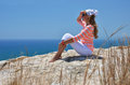 Girl on the rock looking to ocean cyprus Royalty Free Stock Photos