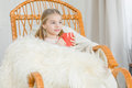 Girl in rocking chair Royalty Free Stock Photo