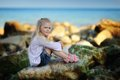 Girl on the rocks Royalty Free Stock Photo