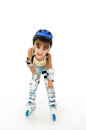 Girl roller four years old with and gear resting Stock Photography