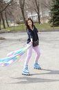 Girl in roller skate in the street. Royalty Free Stock Photo