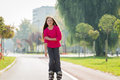 Girl on the rollerblades rides roller skates Stock Photo