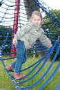 Girl on rope climbing frame Royalty Free Stock Photos