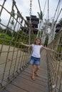 Girl on a rope wood bridge, Sentosa Island Royalty Free Stock Photo