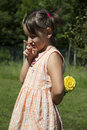Girl with rose happy a yellow Royalty Free Stock Photography