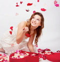 Girl with rose petals Stock Photos