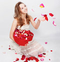 Girl with rose petals Royalty Free Stock Image
