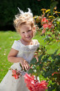 Girl in roses garden Stock Images