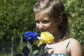 Girl with roses happy blue and yellow Royalty Free Stock Image