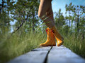Girl with rubber boots wearing rain at swamp Royalty Free Stock Photo