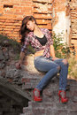 Girl on the ruins sexy in torn jeans old Royalty Free Stock Photos